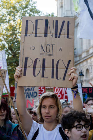 London, United Kingdom, 20th September 2019:- Climate Change Protesters gather in Westminster, central London near the British Parliament as part of a global day of protest Reklamní fotografie - 132419032