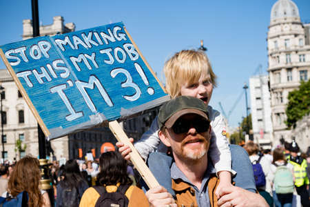 London, United Kingdom, 20th September 2019:- Climate Change Protesters gather in Westminster, central London near the British Parliament as part of a global day of protest Reklamní fotografie - 132419037
