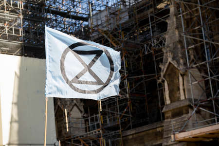 London, United Kingdom, 20th September 2019:- Climate Change Protesters gather in Westminster, fly the flag of Extinction Rebellion Reklamní fotografie - 132419038