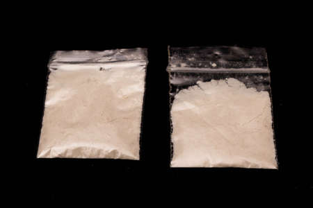 Crime concept showing plastic bags filled with white powder representing drugs ready for sale Reklamní fotografie
