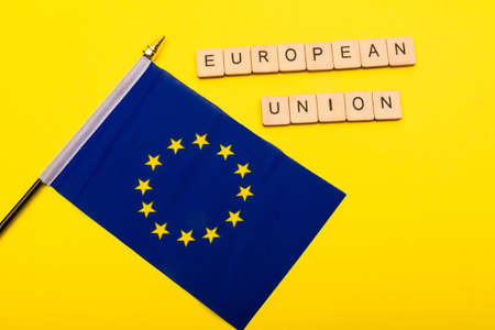 European union concept showing the flag of the EU on a yellow background with a sign reading European Union Reklamní fotografie
