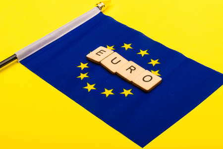 European union concept showing the flag of the EU on a yellow background with a sign reading Euro Reklamní fotografie - 134424302