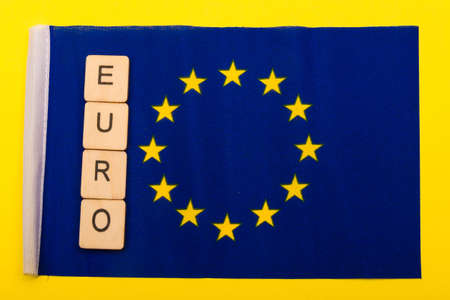 European union concept showing the flag of the EU on a yellow background with a sign reading Euro 写真素材