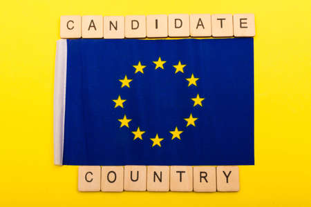 European union concept showing the flag of the EU on a yellow background with a sign reading Candidate Country