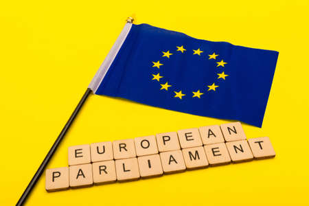 European union concept showing the flag of the EU on a yellow background with a sign reading European Parliament Reklamní fotografie - 134424316