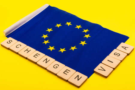 European union concept showing the flag of the EU on a yellow background with a sign reading Schengen Visa