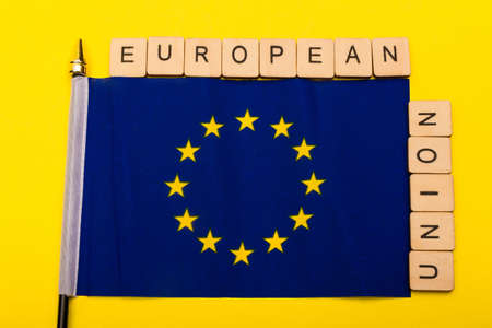 European union concept showing the flag of the EU on a yellow background with a sign reading European Union 写真素材
