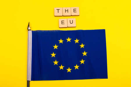 European union concept showing the flag of the EU on a yellow background with a sign reading The EU
