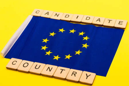 European union concept showing the flag of the EU on a yellow background with a sign reading Candidate Country 写真素材