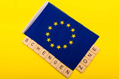 European union concept showing the flag of the EU on a yellow background with a sign reading Schengen Zone