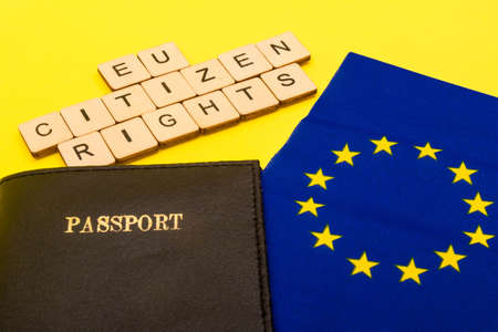 European union concept showing the flag of the EU and a passport on a yellow background with a sign reading EU Citizen Rights 写真素材