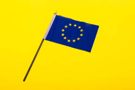 European union concept showing the flag of the EU on a yellow background