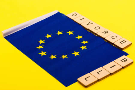 European union concept showing the flag of the EU on a yellow background with a sign reading Divorce Bill 写真素材