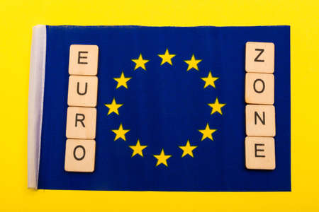 European union concept showing the flag of the EU on a yellow background with a sign reading Euro Zone 写真素材