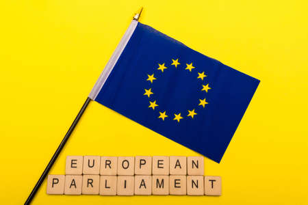 European union concept showing the flag of the EU on a yellow background with a sign reading European Parliament 写真素材