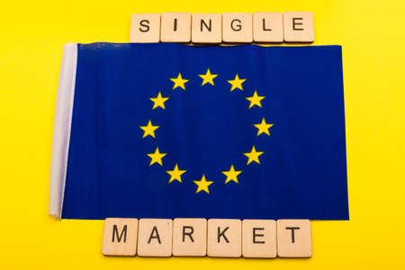 European union concept showing the flag of the EU on a yellow background with a sign reading Single Market 写真素材