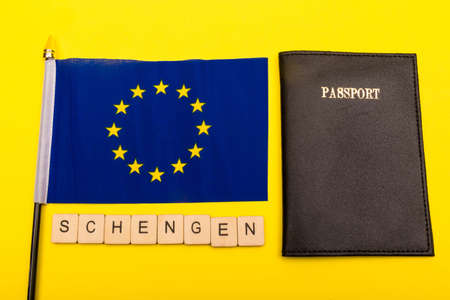 European union concept showing the flag of the EU on a yellow background with a sign reading Schengen