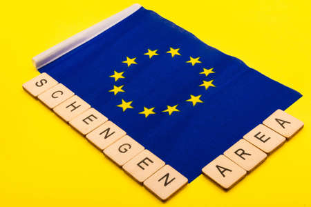 European union concept showing the flag of the EU on a yellow background with a sign reading SChengen Area