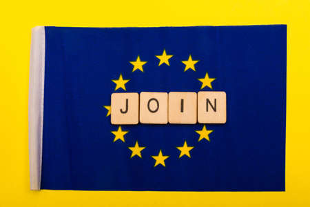 European union concept showing the flag of the EU on a yellow background with a sign reading Join