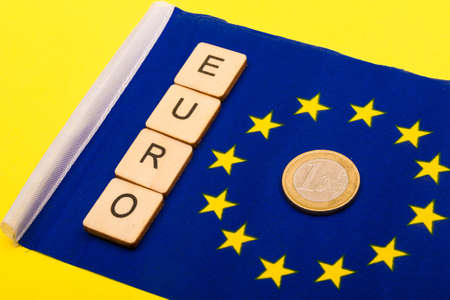 European union concept showing the flag of the EU on a yellow background with a sign reading