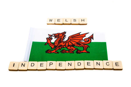 The national flag of Wales on a white background with a sign reading Welsh Independence