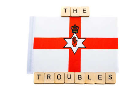 The national flag of Northern Ireland on a white background with a sign reading The Troubles