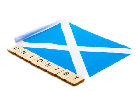 The national flag of Scotland, the Saltaire or cross of St Andrews on a white background with a sign reading Unionist
