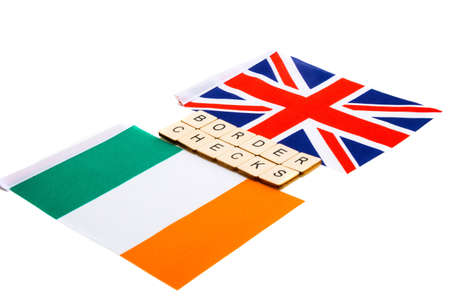 The national flag of the United Kingdom and the Republic of Ireland on a white background with a sign reading Border Checks