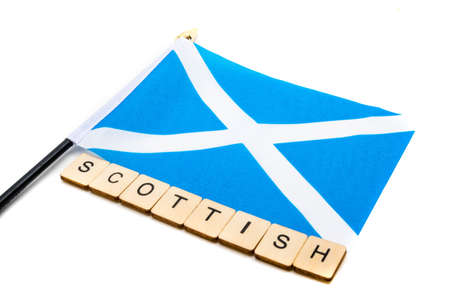 The national flag of Scotland, the Saltaire or cross of St Andrews on a white background with a sign reading Scottish Banque d'images