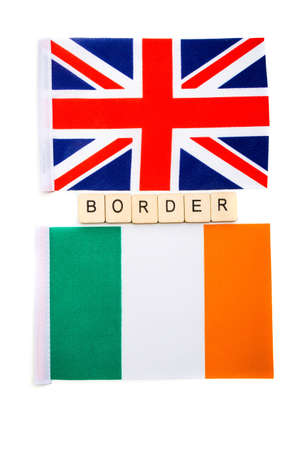 The national flag of the United Kingdom and the Republic of Ireland on a white background with a sign reading Border