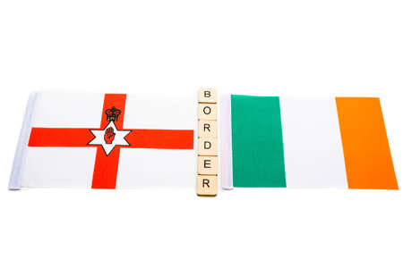 The national flag of Northern Ireland and the Republic of Ireland on a white background with a sign reading Border