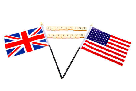 The flags of the United Kingdom and the United States isolated on a white background with a sign reading Different Cultures
