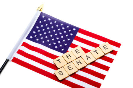 The flag of the United States isolated on a white background with a sign reading The Senate