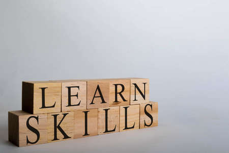 Wooden cubes with lettering spelling Learn Skills. Business, school or politcal concept