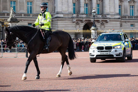 London, United Kingdom, March 8th 2020:- A police officer on horseback and police vehicle outside Buckingham Palace