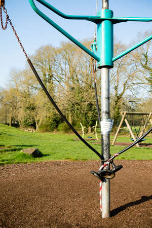 Sandhurst, United Kingdom, 9th April 2020:- Taped off children's play equipment in a closed play park during the Covid-19 outbreak Éditoriale
