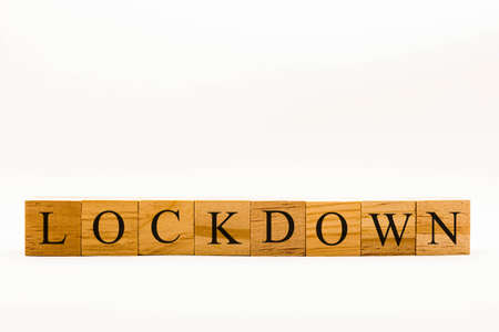 Coronavirus concept showing wooden blocks on a white background reading Lockdown Banque d'images
