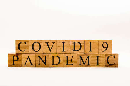 Coronavirus concept showing wooden blocks on a white background reading Covid19 Pandemic Banque d'images
