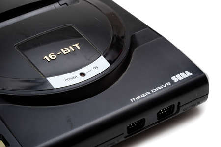 London, United Kingdom, 21st September 2020:- A retro Sega Mega Drive 16-bit gaming console isolated on a white background Publikacyjne