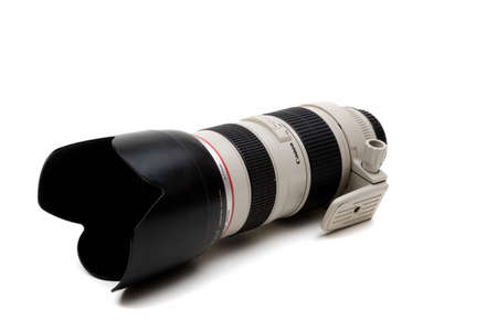 London, United Kingdom, 21st September 2020:- A canon 70-200mm f2.8 USM L Lens with lens hood isolated on a white background