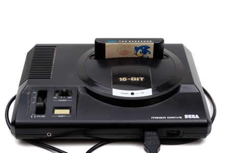 London, United Kingdom, 21st September 2020:- A retro Sega Mega Drive 16-bit gaming console with Sonic The Hedgehog Game isolated on a white background Editorial
