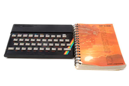 London, United Kingdom, 21st September 2020:- A retro Sinclair ZX Spectrum 48k home computer and programming book isolated on a white background Editorial
