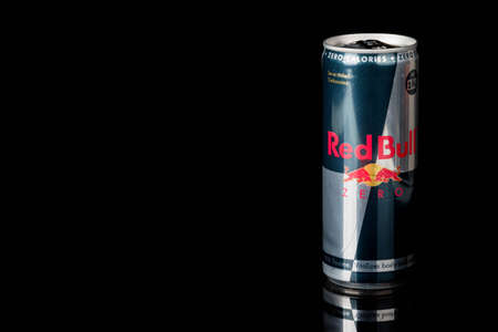 London, United Kingdom, 14th October 2020:- A can of RedBull Zero Calories Energy Drink Isolated on a black background Redakční