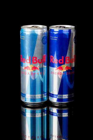 London, United Kingdom, 14th October 2020:- Cans of Redbull and Sugar Free Energy Drinks Isolated on a black background