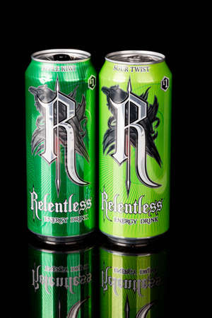 London, United Kingdom, 14th October 2020:- Cans or Relentless Apple Kiwi & Sour Twist Energy Drinks Isolated on a black background