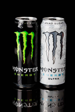 London, United Kingdom, 14th October 2020:- Cans of Monster & Sugar Free Ultra Energy Drinks Isolated on a black background