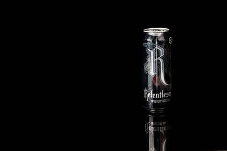 London, United Kingdom, 14th October 2020:- A can of Relentless Origin Energy Drink Isolated on a black background