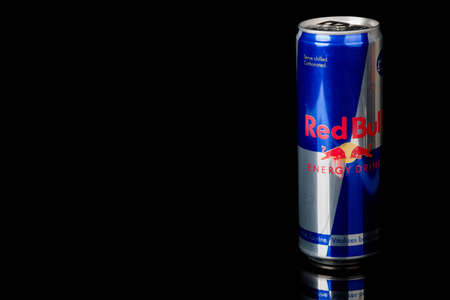 London, United Kingdom, 14th October 2020:- A can of Redbull Energy Drink Isolated on a black background Redakční