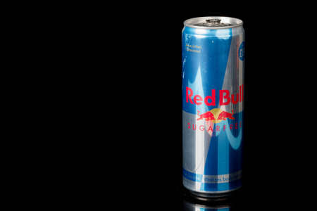 London, United Kingdom, 14th October 2020:- A can of Redbull Sugar Free Energy Drink Isolated on a black background