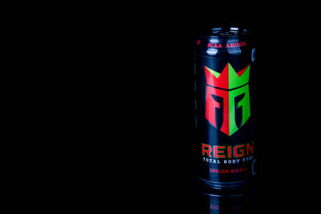 London, United Kingdom, 14th October 2020:- A can of Reign Melon Mania Energy Drink Isolated on a black background